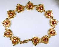 claddagh filigree hears bracelet in two tone gold