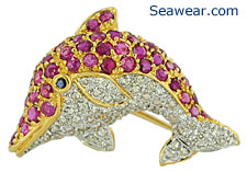 18kt dolphin with diamonds, rubies and sapphire