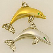 dolphin pendant with emerald eyes and .25cts of diamonds