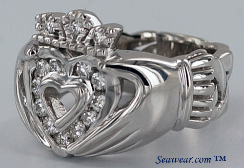 polished hands offering of the Claddagh heart with diamonds