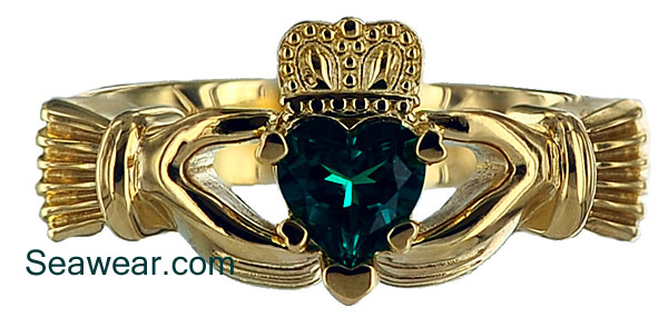 emerald Claddagh ring with heart shaped prongs