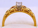 14k Celtic engagement ring with .15ct SI diamond