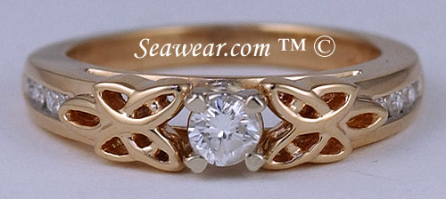 yellow gold Irish love knot engagement ring with 1/4ct diamond and Claddagh heart prongs