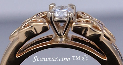 14kt yellow Irish love knots with 1/4ct diamond in white gold heart shaped prongs