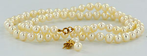 white pearl necklace and earrings with 14kt gold findings