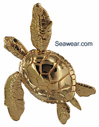 14kt gree sea turtle with emerald eyes with all moving flippers, tail and head.